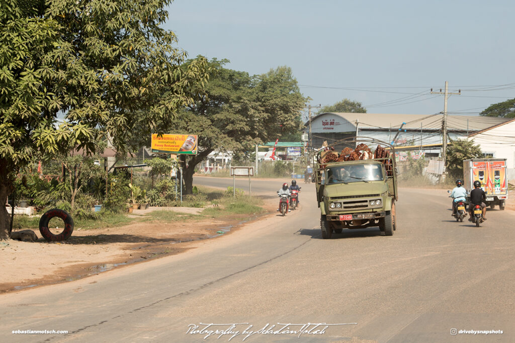 Chinese Truck with Wood Carvings Street Scene Laos Vientiane Drive-by Snapshots by Sebastian Motsch