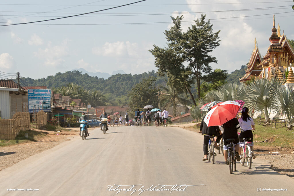 Cycling in Laos on Mountain Road 13 Drive-by Snapshots by Sebastian Motsch