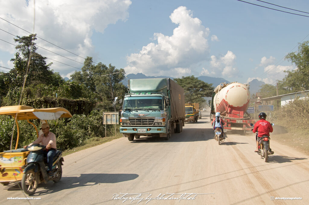 Motorcycle Sidecar and Hino Truck in Laos on Mountain Road 13 Drive-by Snapshots by Sebastian Motsch