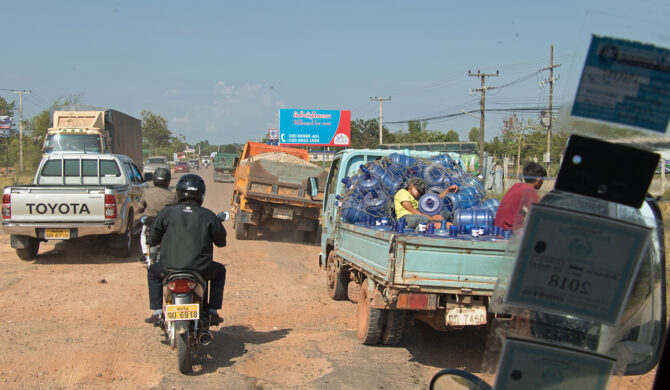 Street Scene with Trucks and Scooters Laos Drive-by Snapshots by Sebastian Motsch