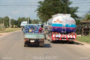 Street Scene with two Trucks Laos Drive-by Snapshots by Sebastian Motsch