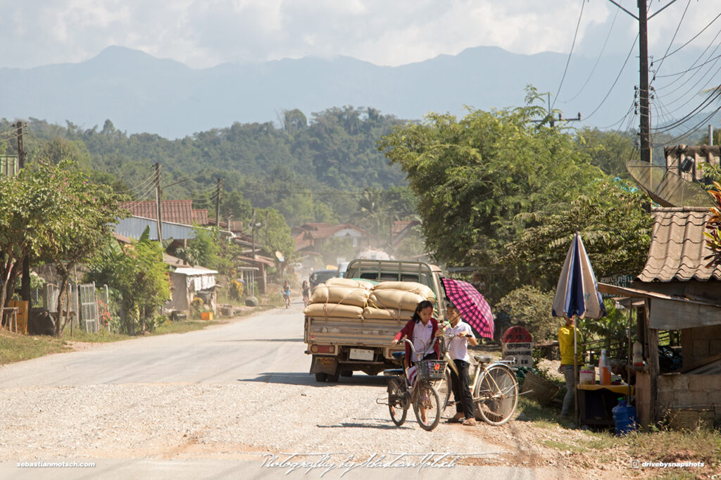 Town in Laos on Mountain Road 13 Drive-by Snapshots by Sebastian Motsch