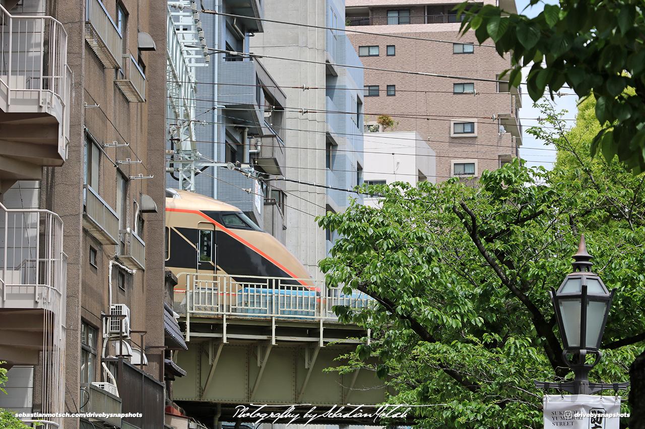 Japan Tokyo Asakusa Tobu Isesaki Line Train exiting Building by Sebastian Motsch