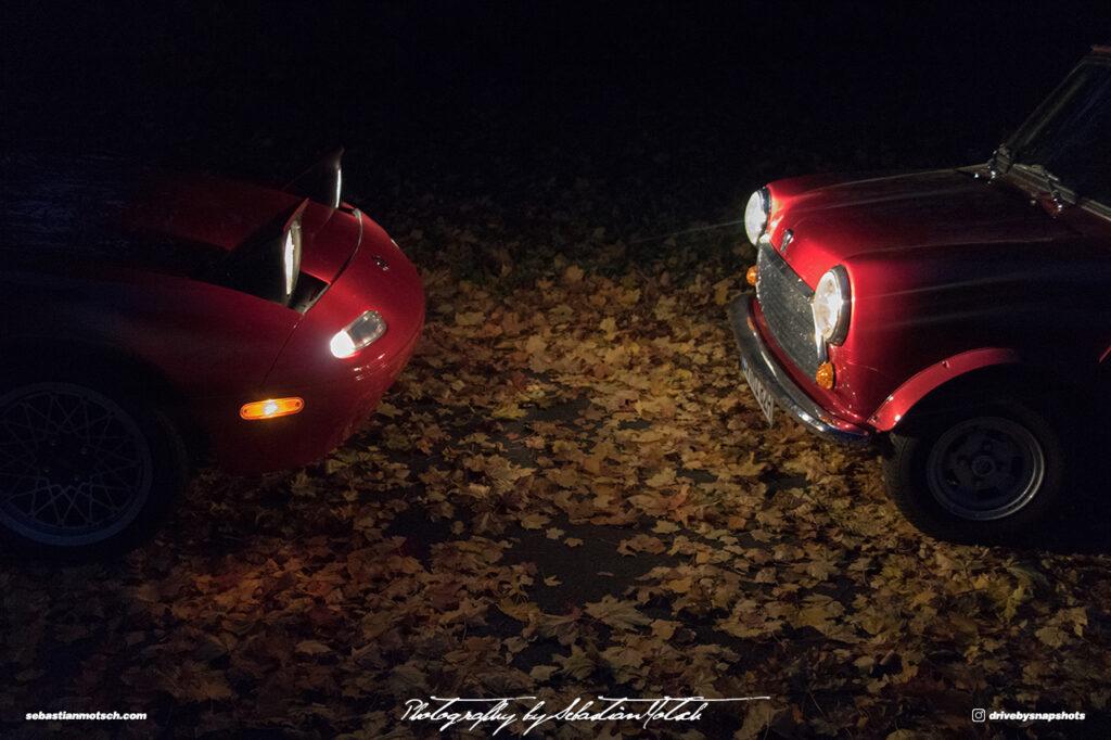 Mazda Miata NA and Austin Mini Fall Leaves by Sebastian Motsch
