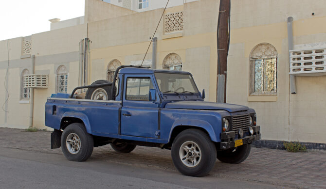 Land Rover Defender LWB Pick-up Oman Muscat Drive-by Snapshot by Sebastian Motsch front