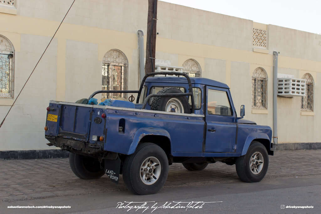 Land Rover Defender LWB Pick-up Oman Muscat Drive-by Snapshot by Sebastian Motsch rear
