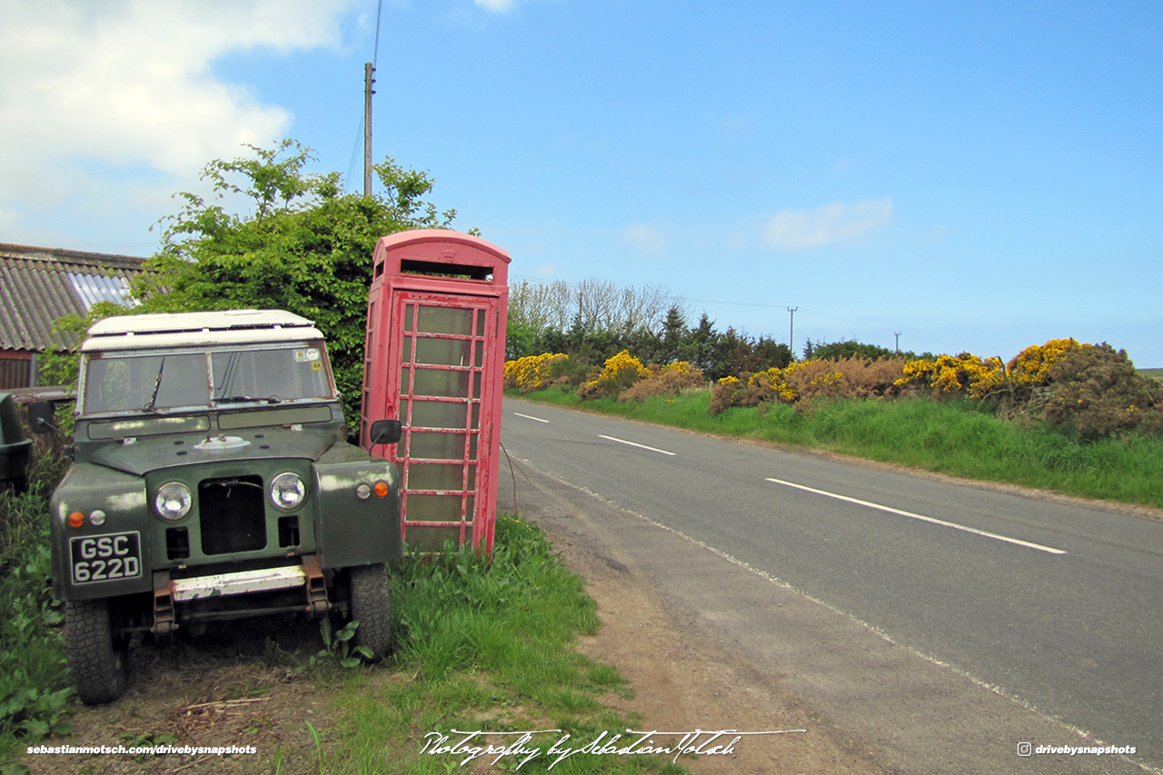 Land Rover Series II SWB Scotland with Red Telephone Booth Drive-by Snapshot by Sebastian Motsch